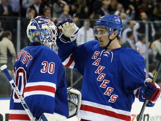 macdonagh-and-lundqvist-vs.-pens.jpg