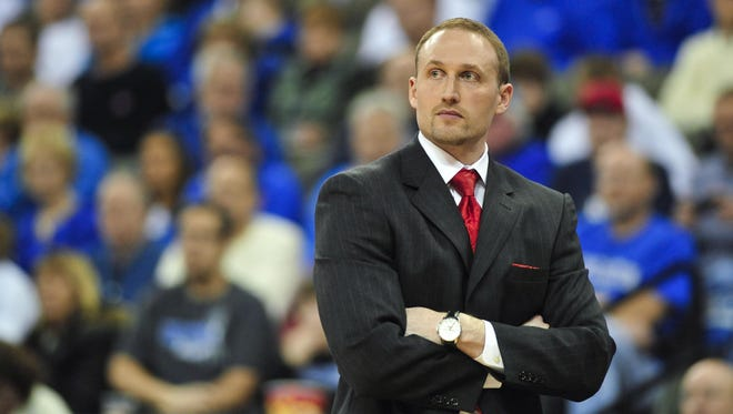 Coach Dan Muller, through his own grief, found a new purpose after the crash that killed seven of the Redbird athletic family. Basketball could help heal Illinois State.