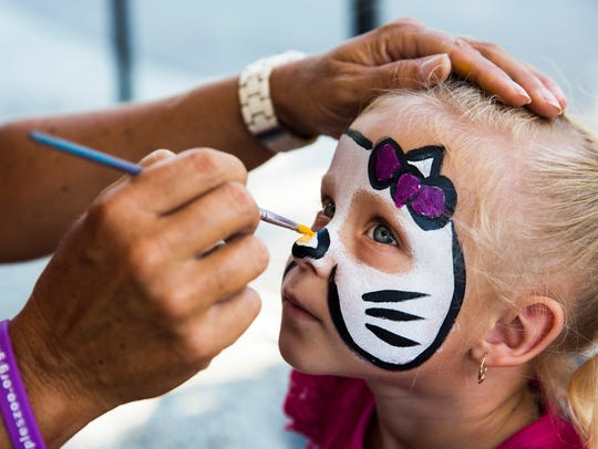 Brooklyn Coffey, 4, has her face painted at the Naples Zoo on Saturday, Oct. 14, 2017. The zoo is offering free admission for Collier County residents and $5 for Florida residents through this weekend.