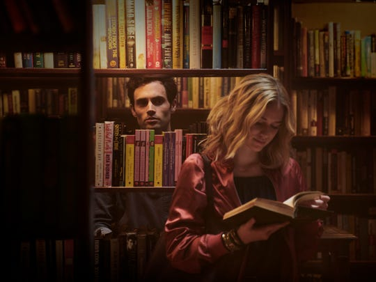 "Penn Badgley and Elizabeth Lail in ""You."""