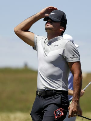 Jason Day, of Australia, reacts on the ninth hole during the second round of the U.S. Open golf tournament Friday. Day was among the group of top-ranked players who missed the cut.