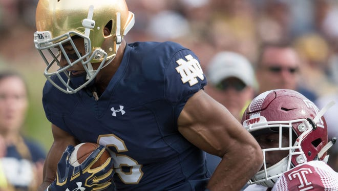Fighting Irish wide receiver Equanimeous St. Brown (6) catches a pass as Temple Owls linebacker Sam Franklin (36) defends in the second quarter at Notre Dame Stadium.
