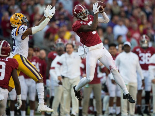 The Dallas Cowboys selected Alabama cornerback Trevon Diggs (right) in the second round of the NFL Draft.