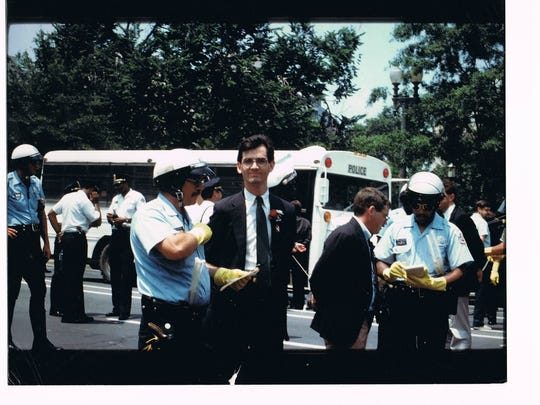 Sean's arrest in front of the Whitehouse 1987.jpg