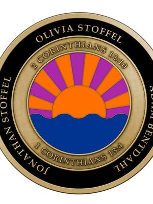 A challenge coin pays tribute to three people killed in the May 3 Trestle Trail shooting in Menasha. The coin features a setting sun and the victims' favorite Bible verses.