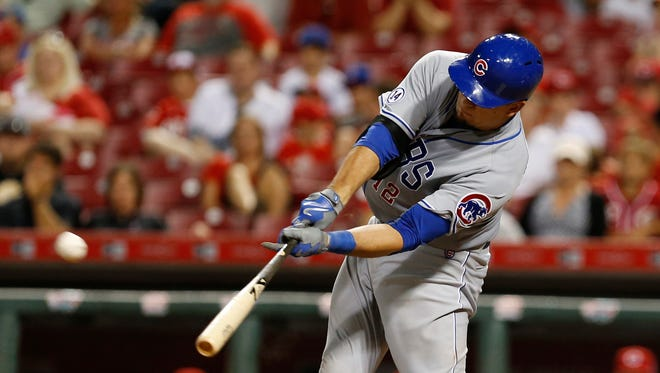 Chicago Cubs' Kyle Schwarber hits a go-ahead home run off Cincinnati Reds relief pitcher Nate Adcock during the 13th inning of a baseball game, Tuesday, July 21, 2015, in Cincinnati. The Cubs won 5-4.