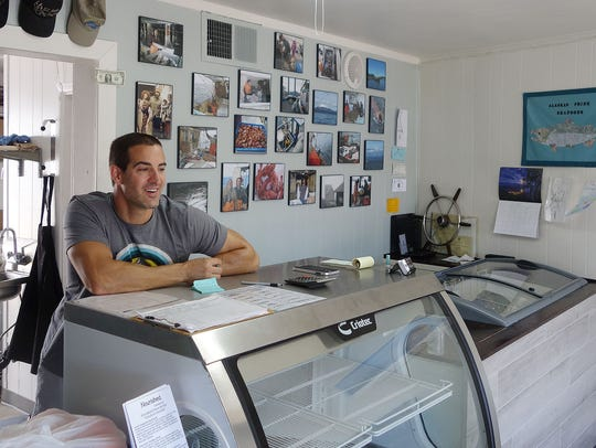 Cedar Mulligan oversees his new seafood shop, Alaskan