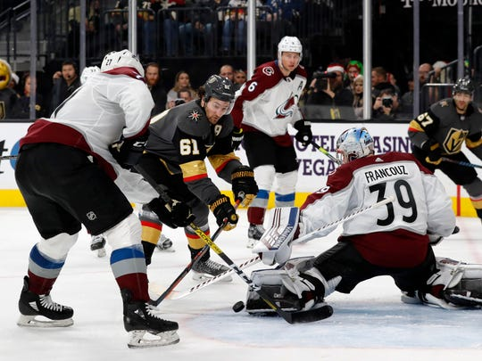 Colorado Avalanche goaltender Pavel Francouz (39) blocks a shot by Vegas Golden Knights right wing Mark Stone (61) during the second period of an NHL hockey game Monday, Dec. 23, 2019, in Las Vegas. (AP Photo/Steve Marcus)