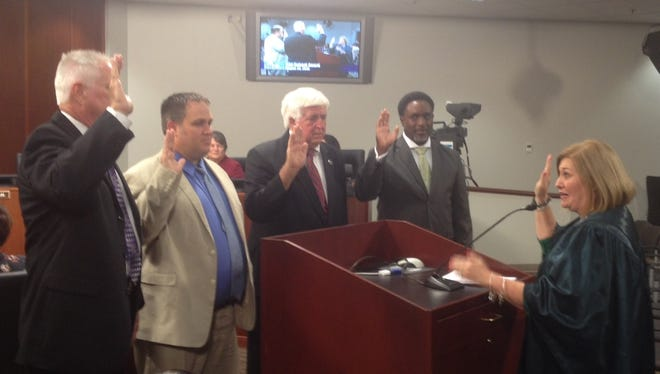 Judge Donna Davenport, right, swears in school board members at the Tuesday night meeting of the Murfreesboro City School Board. From left are  newcomer Wesley Ballard, Jared Barrett, Butch Campbell and newcomer David Settles.
