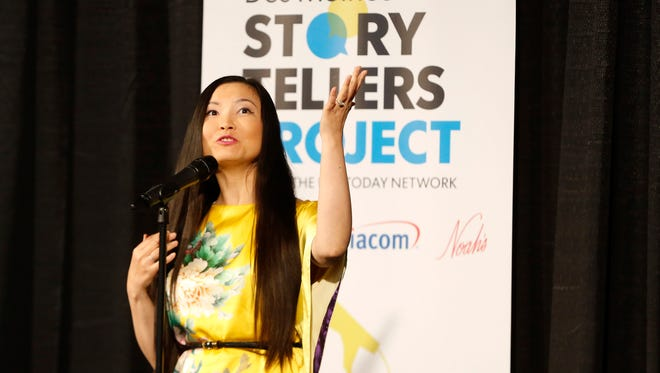 Li Zhao tells her story of growing up as a little feminist in China Thursday, June 7, 2018, during the Des Moines Storytellers Project at Curate in Des Moines.