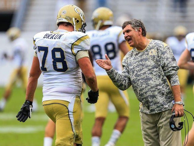 Georgia Tech head coach Paul Johnson talks to Yellow Jackets offensive lineman Trey Braun as he walks off the field. Braun was a standout two-way player during his days at Leon High.