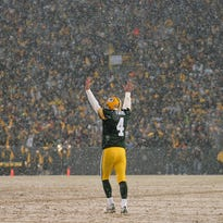Green Bay Packers quarterback Brett Favre celebrates after a touchdown during the Jan. 12, 2008, playoff game against the Seattle Seahawks. The Packers are scheduled to unveil Favre's name and No. 4 on the facade of Lambeau Field during the Thanksgiving Day game.