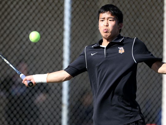 Sprague High School's Shunn Miyachi connects with the ball during a doubles with South Salem their Greater Valley Conference dual meet on Thursday, April 16, 2015, in Salem, Ore.