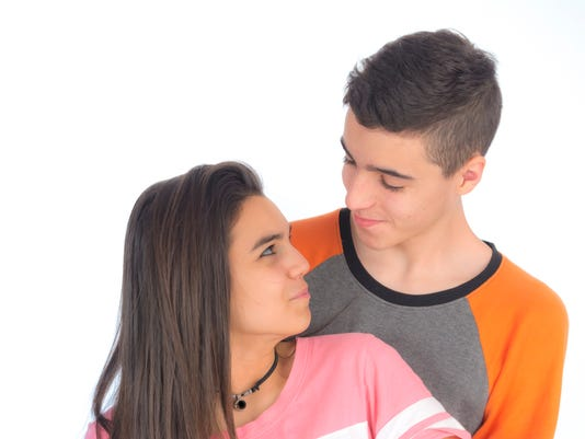 Funny teen couple smiling V
