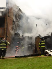 Firefighters battle a blaze at The Arbors in the Town of Hyde Park on May 4.