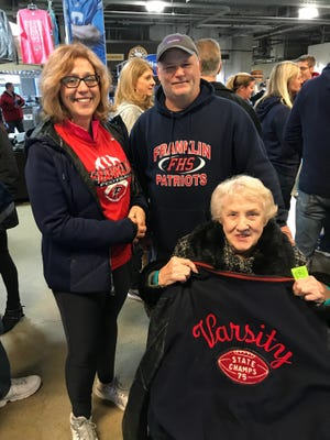Eagerly anticipating the opening kickoff Friday afternoon at Ford Field are (from left) Donna Nehasil, Craig Nehasil and Elsie Lee, Donna's mom. Elsie, celebrating her 91st birthday Friday, was at the 1975 championship game.