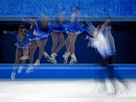 Andrea Davidovich and Evgeni Krasnopolski (ISR) perform in the pairs free skate program.