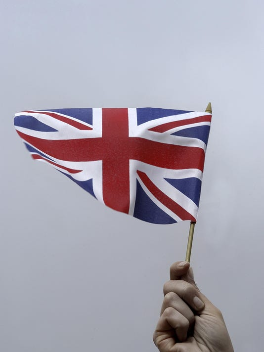 Person holding a flag of the United Kingdom