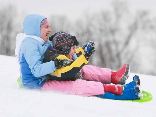Daria Willis, 11, of Bear and her little brother Daniel, 9, have a blast sliding down the hill at Glasgow Park Monday, March 3, 2014.