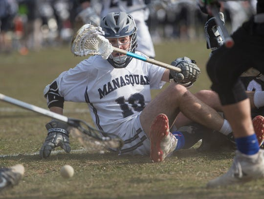 Manasquan's Ryan Anderson looks at the loose ball after