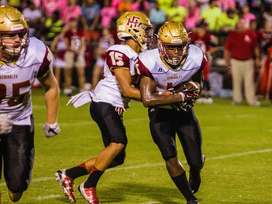 Florida High running back Kevin Sawyer takes a hand-off