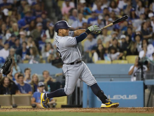 San Diego Padres' Yangervis Solarte hits an RBI double during the fifth inning of a baseball game against the Los Angeles Dodgers, Thursday, July 7, 2016, in Los Angeles. (AP Photo/Jae C. Hong)
