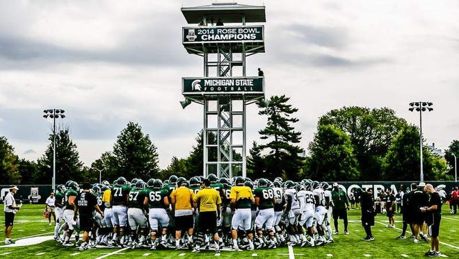 MSU's football team meets after a summer camp practice.