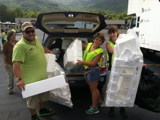 Volunteers from Asheville Greenworks get to work at