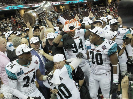 The Arizona Rattlers celebrate their ArenaBowl victory over the Cleveland Gladiators on Aug. 23, 2014.
