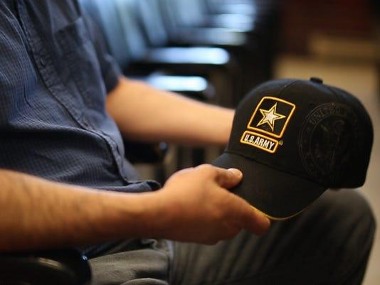 636447228490626457-David-courtroom-hat.jpg