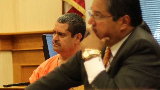 Ruben Gonzalez, left, charged with aggravated murder, during a suppression hearing with his attorney, Esteban Callejas.