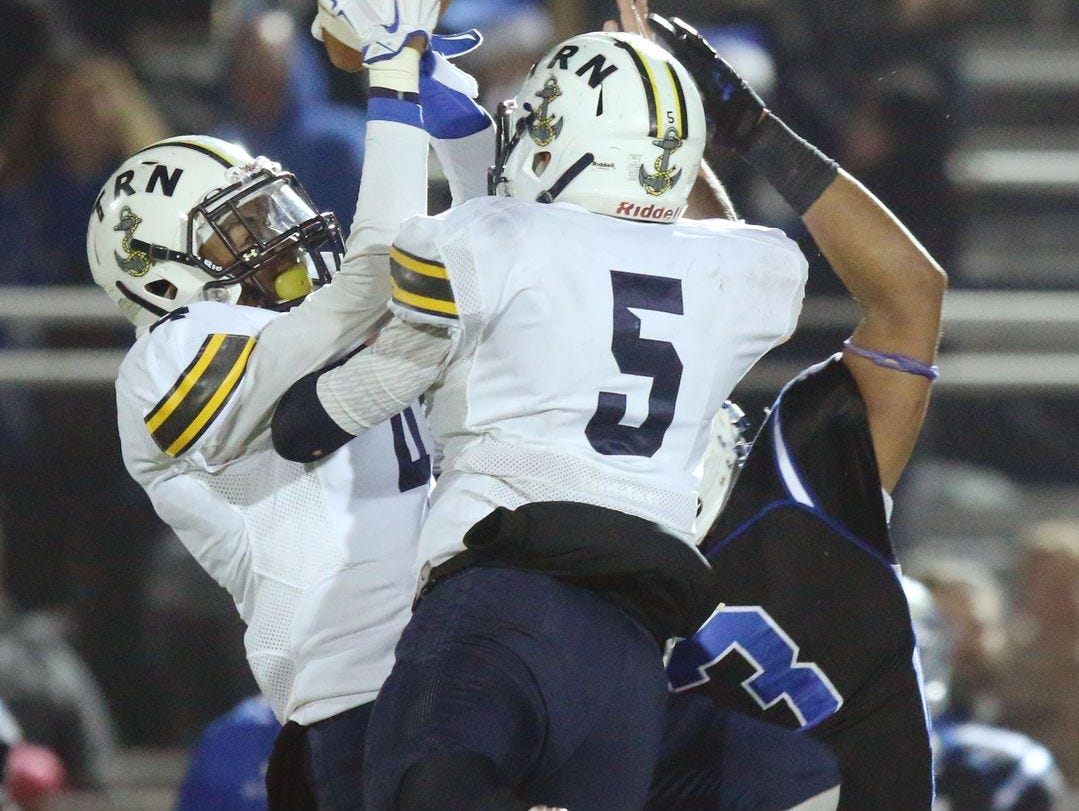 Toms River North's Darrion Carrington makes a key interception late in the fourth quarter.Toms River North defeats Williamstown for the NJSIAA Group V State Championship title. Glassboro, NJ Saturday, December 5, 2015