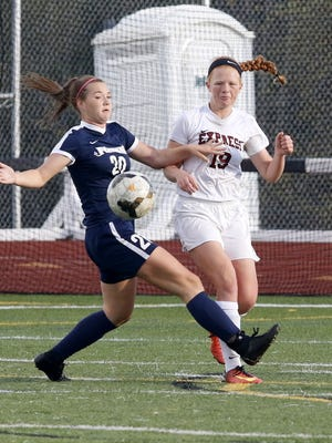 Emma Bough of Chenango Forks, left, and Elmira's Caylee Boorse chase down the ball during the STAC girls soccer final Oct. 17 at Elmira's Ernie Davis Academy.