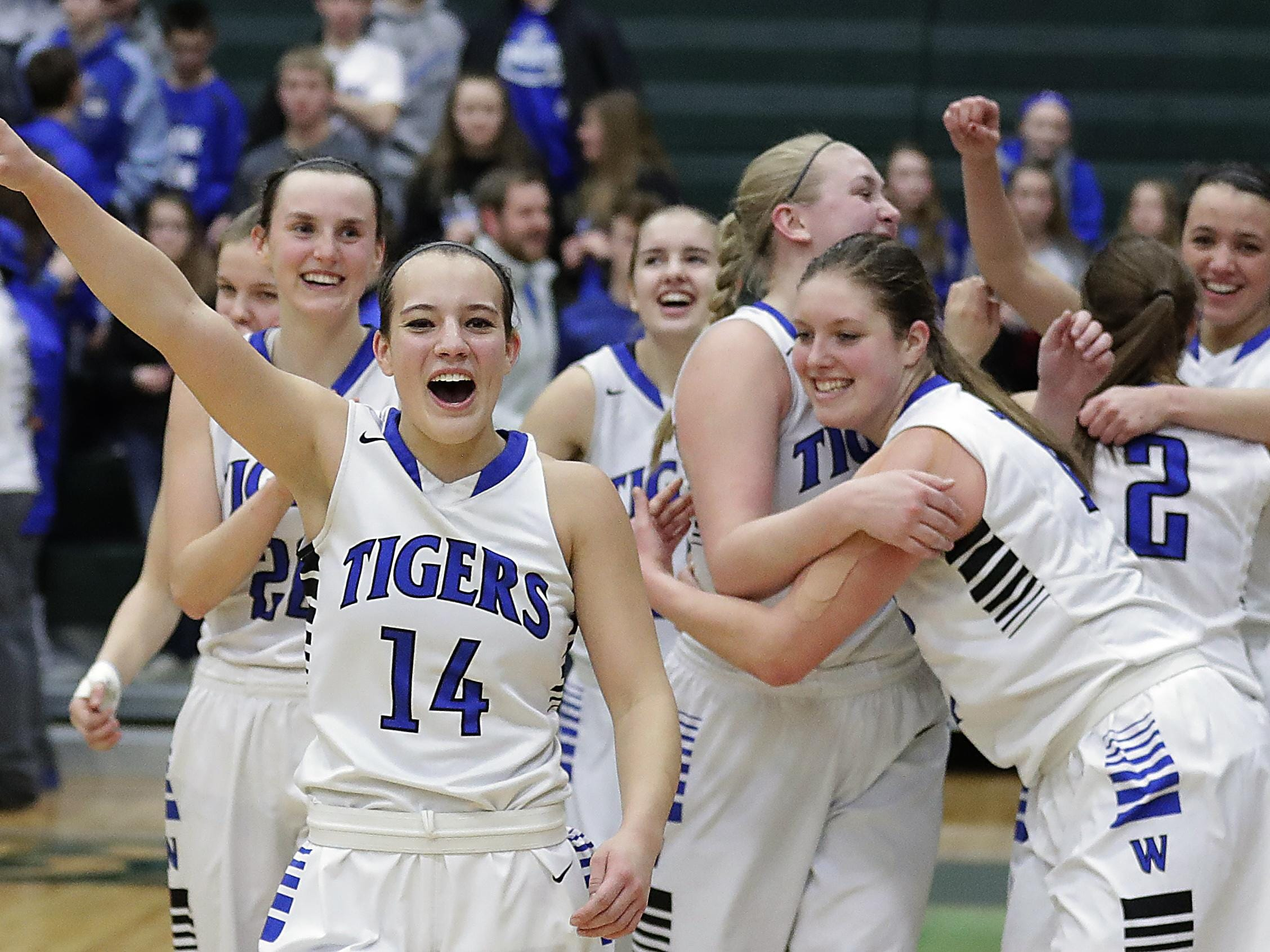 Wrightstown guard Alisha Murphy (14) leads the celebration after the Tigers defeated Amherst to advance to the WIAA Division 3 girls basketball state tournament. See more photos from Saturday's sectional final at greenbaypressgazette.com.
