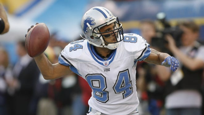 Detroit Lions WR Shaun McDonald  tosses the ball at a San Diego Chargers banner after his TD reception Dec. 16, 2007.