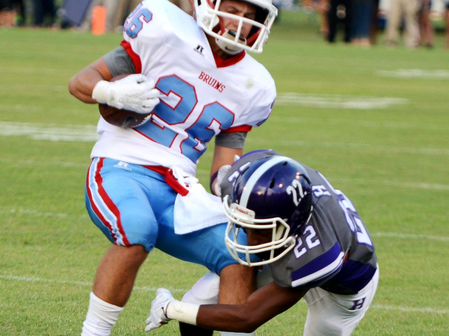Haywood County's Shawn Douglas grabs University School of Jackson's William Jones during their game at the 2015 Sports PLUS Jamboree, Friday evening.