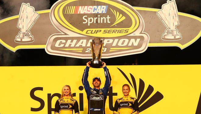 Jimmie Johnson hoists the 2013 NASCAR Sprint Cup championship trophy after the season finale at Homestead-Miami Speedway on Nov. 17. 20131117_jel_su5_091.jpg