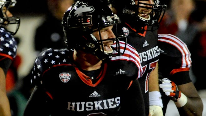 Northern Illinois Cardinals quarterback Jordan Lynch yells after scoring a touchdown during the 2nd quarter against Ball State Huskies at Huskie Stadium.