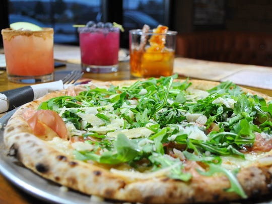 Artisan pizzas pair great with handcrafted cocktails at Cinder Bar in East Greenwich Township.