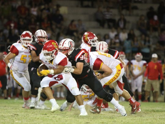 Palm Desert's Manny Sepulveda runs the ball during