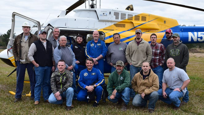 Rescue 7 crew members Michael McDonald (beard), Mitchell Bass and Tim Damico, in the blue overalls, pose with Leaf River employees during a recent training and knowledge share session in New Augusta. Also pictured from left are employees Dale Fulmer, Robert Ragar, Craig Little, Vic Billingsley, Keith Henry, Joel Faurot, Derek Sims, Josh Goff, Miles Mayo, Marc Shoemake, Micah Cochran, Jared Lowery and Chris Rounsaville.