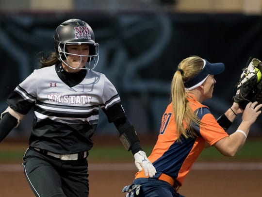 New Mexico State's Amy Bergeson beats the throw to
