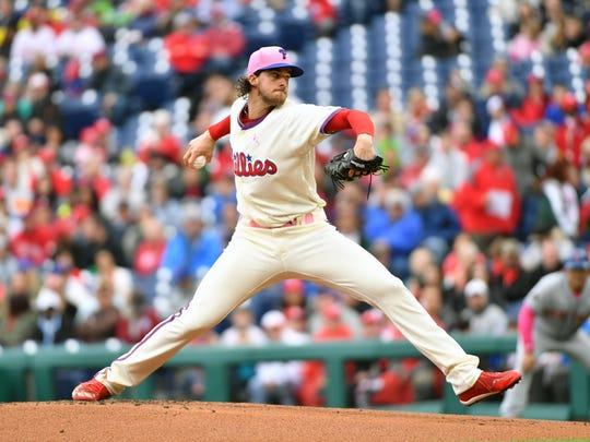 Philadelphia Phillies starting pitcher Aaron Nola (27) throws a pitch during the first inning against the New York Mets at Citizens Bank Park.