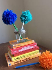 No one will accidentally pocket these pencils. Give your pencils a bold look with these yarn puffs.