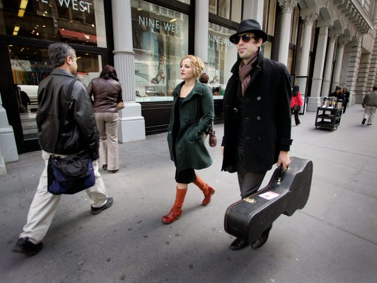 Adriel Denae walks with Cory Chisel in New York City in 2008.