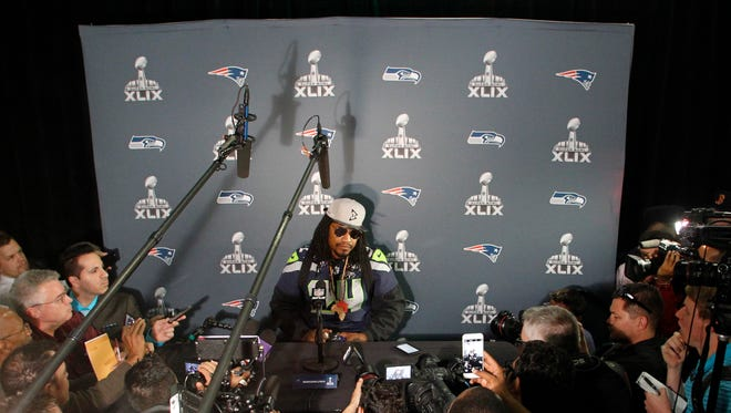 Seahawks running back Marshawn Lynch with reporters during the Seattle Seahawks press conference at Arizona Grand on Wednesday.