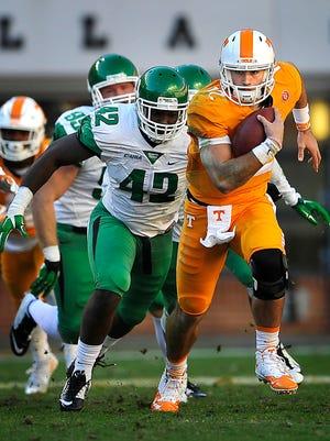 Tennessee quarterback Quinten Dormady (12) scrambles against North Texas on Nov. 14, 2015.