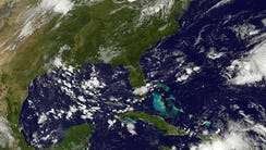 This satellite photo taken August 25 shows storm activity