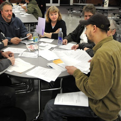 St. Cloud residents take part in a 2012 GOP caucus at Apollo High School.