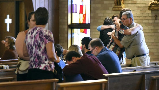 It was an emotional ending to a prayer service in memory of Samuel Traut on Wednesday at the St. Francis Xavier Catholic Church in Sartell. Traut, a North Dakota State University student, was killed in Fargo.
